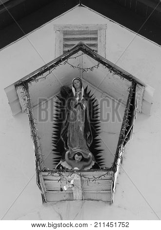 Guadalupe shrine on church exterior, Shafter, Texas