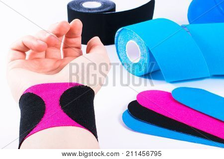 hand with kinesiology tape. Physiotherapy and therapeutic tape for wrist pain, aches and tension. elastic therapeutic tape. adhesive tape and alternative medicine. poster