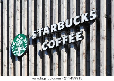 Villefranche, France - July 15, 2016: Starbucks logo on a wall. Starbucks is an American coffee company and coffeehouse chain