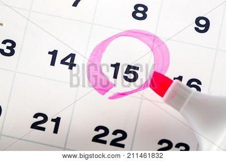Circle calendar personal organiser written date numbers red horizontal