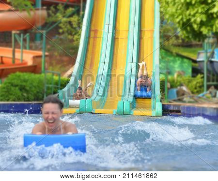 Happy family having fun in aqua park