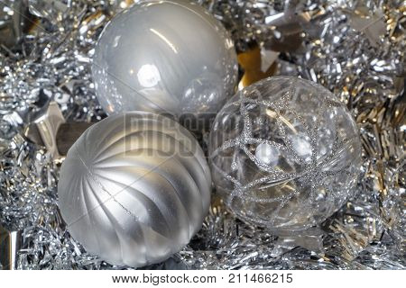Silvery baubles and tinsel as decoration for Christmas