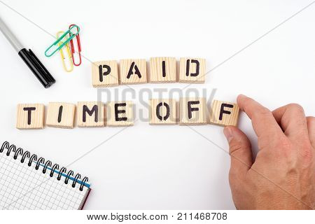 paid time off. Wooden letters on a white background.
