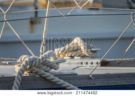 detail of sailor knot rope cleat on a sail boat at sea