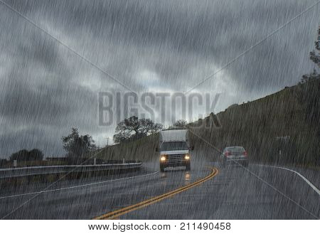 Road with car and truck in heavy rain.
