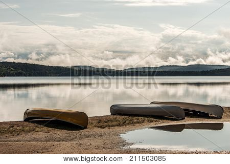 Canada Ontario Lake of two rivers Canoe Canoes parked on beach near the water in Algonquin National Park