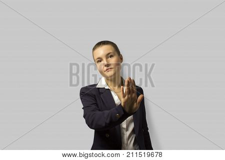 Portrait Shot. Young Beautiful Business Woman With Short Hair Combed Back, Wearing A Jacket.