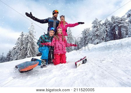 happy family enjoying and having fun on winter vacation together on the mountain