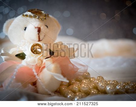 Bear doll bride wearing wedding dress on luxury background decoration and beautiful bokeh. wedding card greeting concept for lovely theme. wedding backdrop frame decorate