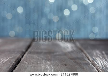 Wooden plank with brilliant background