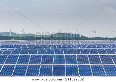 solar power station with wind farm clean energy background