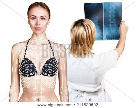 Radiologist woman checking x-ray near patient with paint sceleton, health care concept.