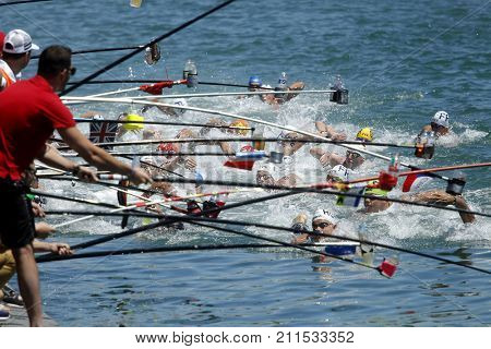 BARCELONA, SPAIN - JULY, 1: Swimmers at the Refreshment point of the open waters event during a Len European open waters swimming CUP on July 1, 2017 in Barcelona Spain