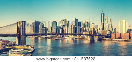 Brooklyn bridge and Manhattan at sunny day, New York City
