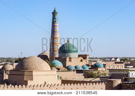 Islam Khoja Minaret and moque in Itchan Kala, the inner town of the city of Khiva - Uzbekistan