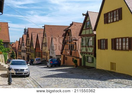 Dinkelsbuhl, Germany - August 28, 2010: Street view of Dinkelsbuhl one of the archetypal towns on the German Romantic Road with traditional frameworks ( Fachwerk ) house.