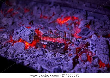 Hot coals in a large barbecue close up in a restaurant