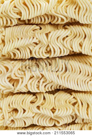 Stacked raw asian instant noodles, close-up image