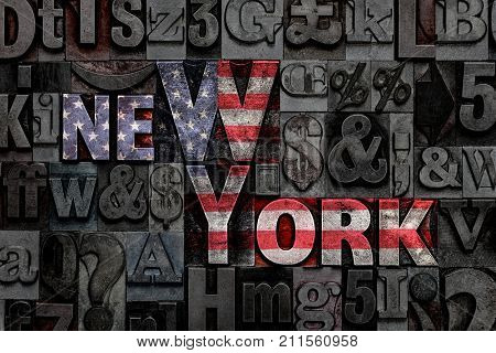 The words New York made from old metal letterpress letters with the colours of the American flag