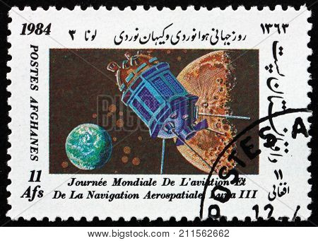 AFGHANISTAN - CIRCA 1984: a stamp printed in Afghanistan shows Luna 3 international day of the space research circa 1984