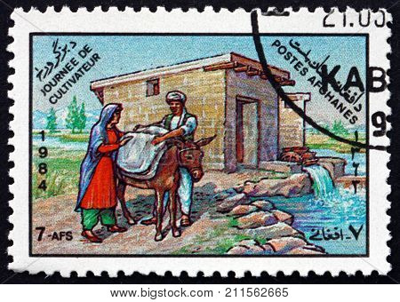 AFGHANISTAN - CIRCA 1984: a stamp printed in Afghanistan shows watermill, agricultural scene, farmers day, circa 1984