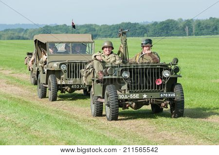 DUNSFOLD, UK - AUGUST 26: Part of a parade of vintage military jeeps at a gathering of classic and modern vehicles in Dunsfold, UK - August 26, 2017