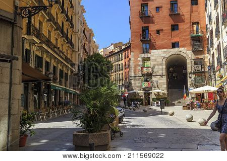 MADRID, SPAIN - MAY 24, 2017: This is an old street near an arched passage to the Plaza Major.