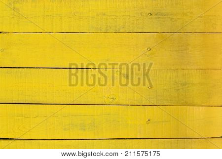 Yellow wood texture and background. Rustic, shabby wooden table. Horizontal timber planks