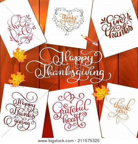 Set of Hand drawn Thanksgiving Day texts. Celebration quotes Happy Thanksgiving, Hello fale, Giving thanks, Grateful heart, Thank you. Vector vintage style calligraphy Lettering with leaves on wooden background.
