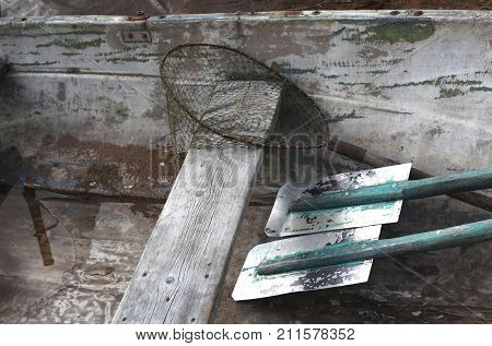 Fishing boat oars and fish nets. Concept of hobbies, tourism, transport