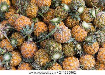 Pineapple background.group of pineapple fruit in steet market.fresh pineapple for sales