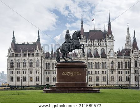 Statue of Ferenc Rakoczi on horseback against the background of the Parliament building in Budapest. Hungary
