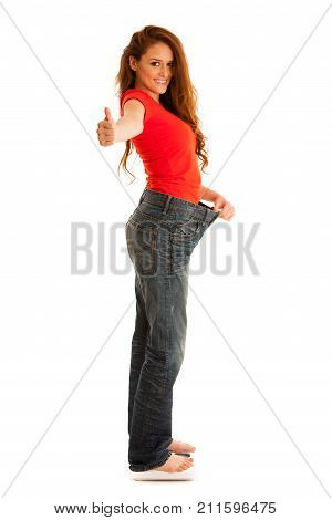 Beautiful Young Woman Holding Scale And Too Big Trousers As She Lost Weight