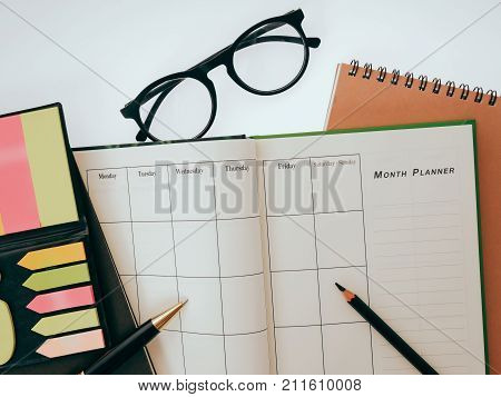 blank planning notebook and pen on desk use us organizer schedule life or business planner concept.