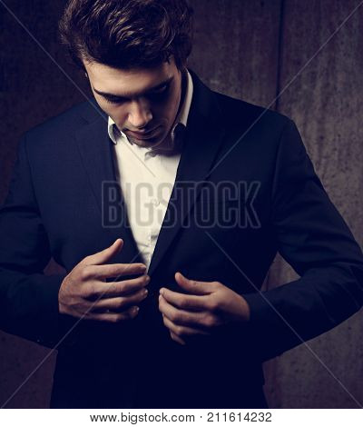Sexy Handsome Business Man In Black Fashion Suit And White Style Shirt On Dark Shadow Background. Cl