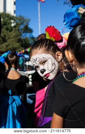 SAN ANTONIO, TEXAS - OCTOBER 28, 2017 - Girl wears face paint and costume for Dia de los Muertos/Day of the Dead - celebrated throughout Mexico and by people of Mexican ancestry living in other places.