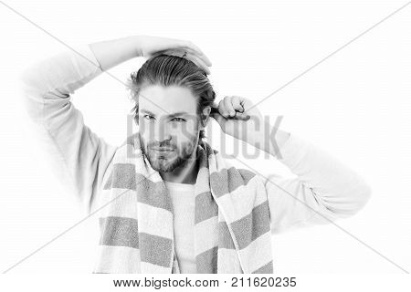 Man With Concentrated Face And Beard Brushes His Wet Hair