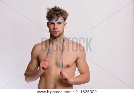 Measurement And Sports Lifestyle Concept. Guy With Flexible Ruler