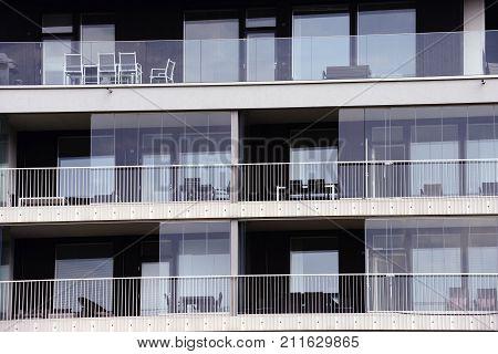 glazed loggias of a modern high-rise building