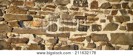 old historic wall of natural stone in a old Town