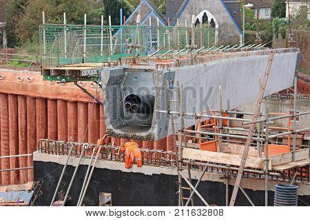 Concrete bridge beam being laid for a new bridge