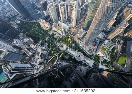 GUANGZHOU, CHINA - AUG 23, 2017: Garden among skyscrapers in Guangzhou, China, view from International Finance Center skyscraper