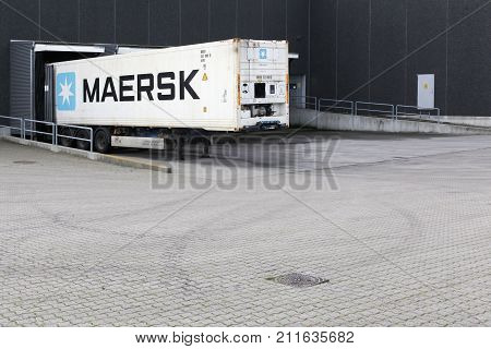 Aarhus, Denmark - October 28, 2017: Maersk truck at a logistic warehouse. Maersk company based in Copenhagen, Denmark, is the largest container ship operator in the world