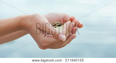 The Panorama Of Handful Of Coins In Palm Female Hands. Concept Of Saving And Passive Income
