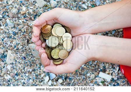 Handful Of Coins In Palm Female Hands. Concept Of Saving And Passive Income