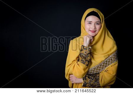 Portrait of beautiful muslim asian woman over black background with happy muslim woman Age 20-30 years.