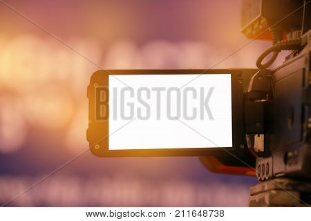 Blur of Video camera or camcorder operator working for record couple speaker or Presenterson stage in conference and convention hall in Vietnam blak white screen on recording poster