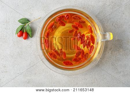 Cup with goji tea on table
