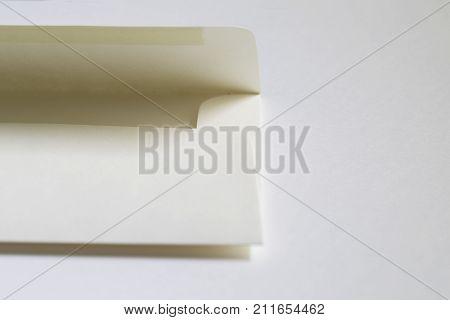 White cream manilla envelope on a white background