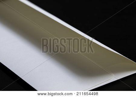 White cream manilla envelope on a black desk